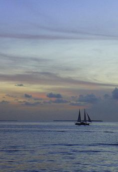 Pastel Sky   Artist  Laurie Perry   Medium  Photograph - Photography   Description  Taken while watching the sun set at Mallory Square in Key West, Florida. My husband and I made sure to catch the Sunset Festival every evening during our vacation in Key West. This beautiful sunset is one of those amazing evening.  #laurieperry