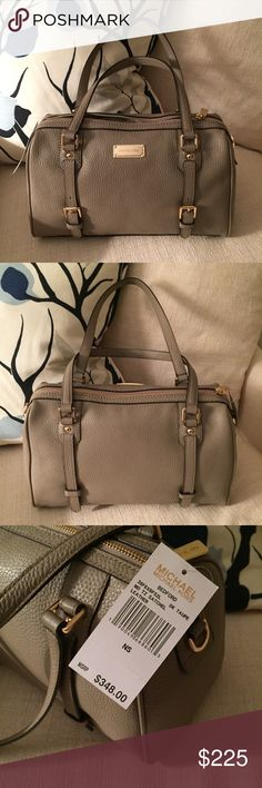 MICHAEL Michael Kors Bedford Leather Satchel NWT MICHAEL Michael Kors Bedford Pebbled Leather Satchel. So elegant! New With Tags. Color: Dark Taupe. Carry handles plus shoulder strap included. Slide in pockets on both sides of interior. No Trades, No PayPal. Quick Ship. MICHAEL Michael Kors Bags Satchels
