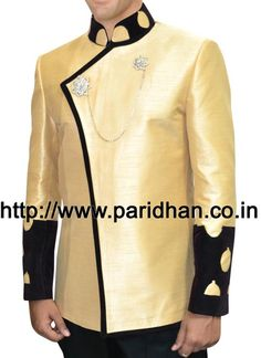 Concealed button angarakha style nehru jacket made in golden rod yellow dupion silk fabric. It has jacket trimmed at front egde by black velvet and has nehru collar and sleeves cuff made by black velvet.