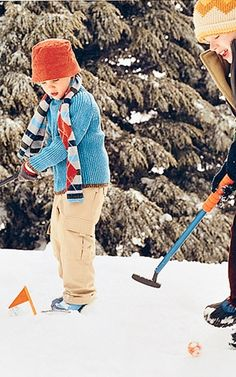Make a golf course by packing down a section of snow every few feet. Bury tin cans halfway down in the snow to create holes, and mark them with mini flagsticks.