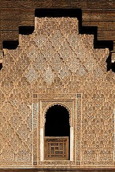 Ornate wall with stucco work, Ali-Ben-Youssef madrasah, historic theological academy in the Medina quarter, Marrakesh, Morocco
