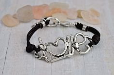 """Love Me Bracelet - You can never have enough love in your life! The word """"love"""" is handcarved and bound on both sides by chocolate leather cord. Love someone, Love thyself, love thy neighbor….it's all good. www.islandcowgirl.com #love #leatherbracelet #islandcowgirl #handmade"""
