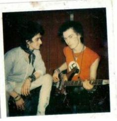 A candid shot of one time and short lived Damned singer Gary Holton with Sid. RIP to them both.