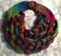 All done!!!  Double layered Braided scarf (Free pattern). H hook (5.00mm); Red Heart Unforgettable Stained Glass yarn - 1 skein only; finished in 4 hours. Link to pattern: http://www.myhobbyiscrochet.com/2016/01/double-layered-braided-cowl-free.html?m=1