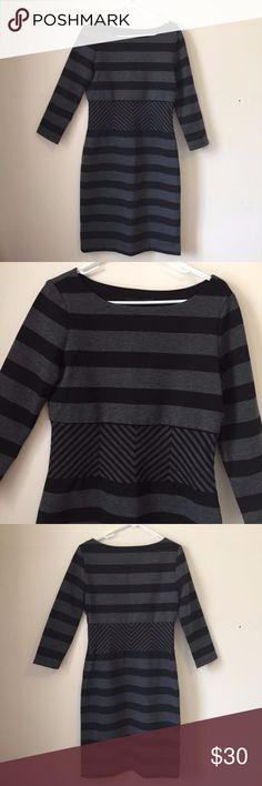 """BCBGMaxAzria Gray Black Striped Roslyn Dress Large Opt for cool sophistication in this BCBGMaxAzria dress of bold, graphic black and grey stripes. Boat neck with three-quarter sleeves. Polyester/rayon/spandex. (Note, belt pictured in stock photo is a styling suggestion only, not included.)  Size large. Excellent condition. Approx. measurements: pit to pit ~18.5"""", waist ~15"""" across, length ~41.5"""". BCBGMaxAzria Dresses"""