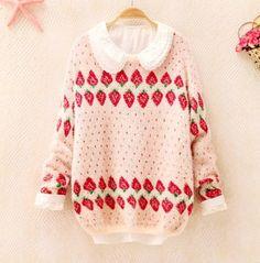 Sweater rosado con frutillas de estampa.