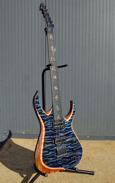 Skervesen Nebelung but with middle layer that's not included in production version. Body: black limba, middle layer : bubinga, top: quilted maple AAAAA grade, high gloss finish. Ebony fretboard with kanji inlay (7 virtues of bushido). Bare Knuckle Pickups Juggernauts calibrated set in black battleworn covers. Hannes bridge, Skervesen's World Domination Mod controls: humbucking/coil split/acoustic mod. Made for Rutger of Bloodphemy and Shinigami bands.