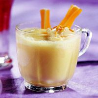 1-14 oz sweetened condn. milk / 1-12oz froz orange juice, thawed / 1 ltr ginger ale / top with orange sherbet
