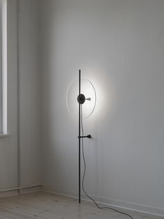 """Secant Light is a minimal light created by Oslo-based designer Daniel Rybakken. The Secant project is about visual and semiotic contrast"""". The Secant Wall (1-5), Floor(6-8) and Table Light (9-13) is a series of hand cut crystal discs suspended and supported by a metal skeleton linking the crystal glass with the light engine and the wall or surface below."""