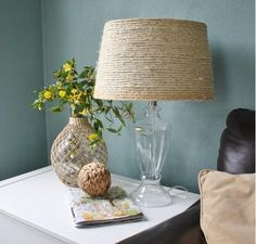 Heat up your hot glue gun because you are going to love this tutorial for a Sisal DIY Lamp Shade! Add to your existing home decor in a simple, classic, and nautical way with sisal rope.