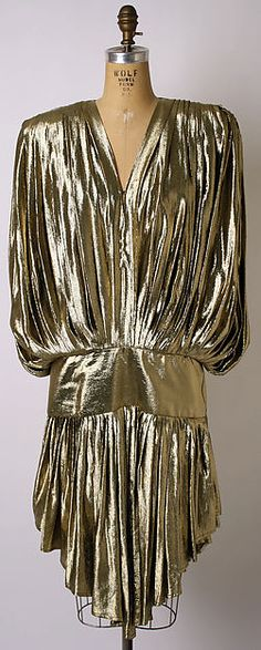 Gold! The 70s were the time of disco and gold reigned supreme as the textile to wear to party. Other metallics were popular too. This dress would definitely be seen at Studio 54 for its color to shine under the lights, and its movability  to dance in. I would do anything to travel back in time and make my way inside Studio 54.