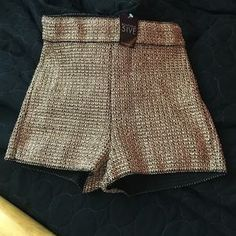 I just discovered this while shopping on Poshmark: High waisted gold shorts. Check it out! Price: $17 Size: S