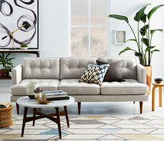Midcentury-style West Elm Peggy sofas at John Lewis