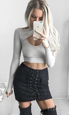 a crop top   suede black skirt with lace up in the front