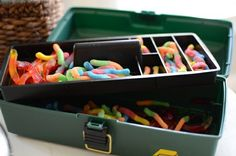 Fish party gummy worms in tackle box