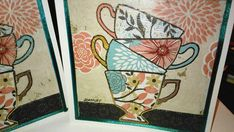 """Square ( approximately 5.5"""" by 5.5"""" ) all occasion greeting cards featuring a stack of 4 floral teacups against a background of tan and black. The designer's ( of the napkin design) signature is present, of course!    Made up from a decorative napkin (!) decoupaged to a blue card stock background which has then been glued to the card front.    Each image is embellished with a coordinating ribbon edging, black gel pen and  gold paint marker.    Charming and unique cards!! Envelopes included…"""