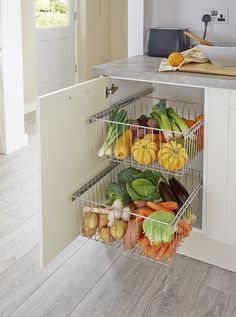 Keep things tidy with this kitchen storage solution shown here in our Burford Ivory kitchen. Take a look at Howdens for more great storage ideas.