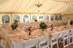 Vintage wedding with white folding chairs now available for hire from http://devonvintagechina.co.uk