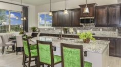 The #kitchen in the Kingston at the Bridges at #Gilbert. #Design #Kitchendecor #Chairs #Dining
