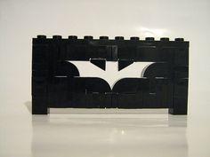 Lego Batman symbol outlined in Legos