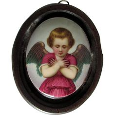 A very pretty antique (circa late 1800s) porcelain plaque.  The plaque depicts a Cherub Angel, she is hand painted on porcelain and has a few