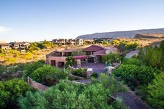 This luxury, upscale custom built adobe home is the absolute finest of its kind. Resting on 1.41 acres and carved into the natural mountain scenery of The Ridges, this unique property offers complete privacy and tranquil earthy views.