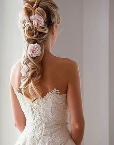 A half-up, half-down hairstyle with hair secured elegantly loose curls and adorned with flowers. | 20 Long #Wedding #Hairstyles 2013 | Confetti Daydreams