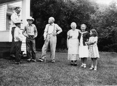 Laura Ingalls Wilder and her husband Almanzo Wilder welcoming guests at their home in Mansfield, Missouri.