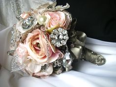Savannah is princess perfect! She is an exquisite antique looking beauty in pink toned hydrangea, silk roses and ranunculus, and pink satin ribbon rosettes.