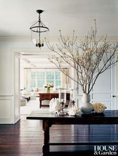 An English refectory table pairs well with the reclaimed-pine-plank flooring in a Hamptons entry. #houseandgarden