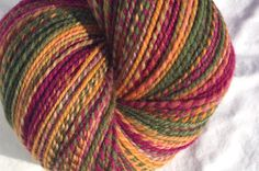 Hand dyed handspun Falkland wool yarn, DK weight in Harvest    4.20 oz/119g  322 yards/294 meters    Shades of muted green, orange, & red-violet.