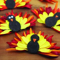 This is so cute! Just use Dollar store flowers, take them apart & fold in half. A great way to keep little ones entertained while the mommy's cook Thanksgiving dinner and the men hijack the tv for football.
