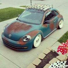VW beetle with white walls and roof rack.