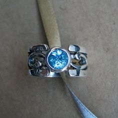 Swiss blue topaz ring  filigree ring  wide scroll by metalicious