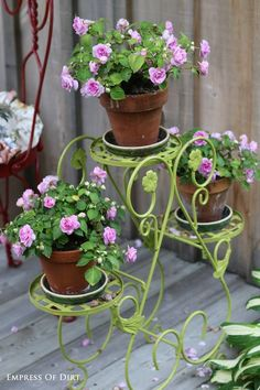 Give an old metal plant stand instant bling with a fresh coat of paint! See a whole bunch of creative garden container ideas you can use in your garden. #spon
