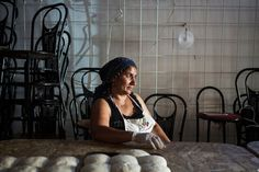 Balkan delicacies — barbecued meatballs, cabbage wraps and stuffed peppers — are the basic ingredients of an entrepreneurial scheme cooked up by a group of Roma women looking to better their lives and leave the overcrowded and insalubrious camp in Rome where they currently live. (Photo: Gianni Cipriano for The New York Times)