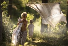 by Russian photographer, Elena Shumilova, who lives on her farm in Russia with her two sons and farm animals