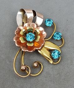Vintage Harry Iskin gold-filled rose gold silver blue crystals flower brooch #HarryIskin