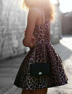 Come shop this Leopard Cocktail Dress and Chanel-inspired bag for less at Luxe Apothetique in Destin, FL!