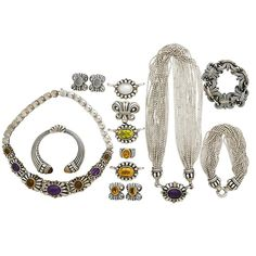 """ourteen pieces: Two necklaces, three bracelets, two pairs of earrings, four enhancers, and a ring. 18-strand bead necklace joined by five interchangeable jeweled enhancers, bracelet en suite; Wheat archive gold trimmed link bracelet, pairs of moonstone or citrine earrings en suite; Signature Caviar two tone sprung bracelet with citrine cabochons; Citrine ring, size 6 1/2; Amethyst and citrine link necklace, 16"""". 603 gs."""