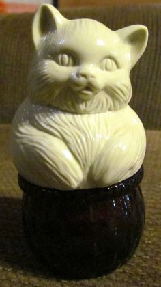 Vintage Avon Kitty Cat Decanter. i remember this thing! i think it was a lotion. didn't smell good but i loved the kitty on it when i was a kid