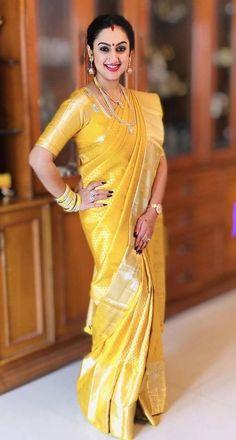 Pritha Hari, South Indian film actress, wore this sunshine yellow Kanchipuram silk saree from Kankatala to Soundarya Rajnikant's wedding in… South Indian Wedding Saree, Indian Bridal Sarees, Indian Silk Sarees, Indian Beauty Saree, Ethnic Sarees, Wedding Sarees, Bridal Blouse Designs, Saree Blouse Designs, Indian Gowns Dresses
