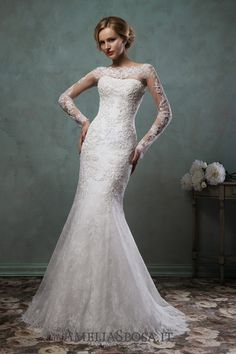 Wedding dress Camelia - AmeliaSposa. Create a dramatic look full of sensuality and temptation. This clinging silhouette with a neat 'tail' exudes calmness and confidence. Combination of several types of laces adds magnificence to the look that is often called aristocratic.
