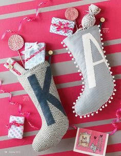 Mini, funky-shaped stockings with mini wrapped gifts! Eeep!