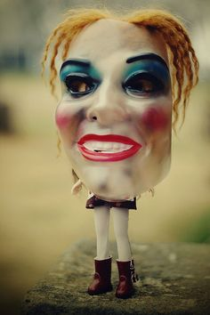 Scary mask on small doll.