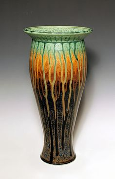 Green & Brown Ash Vase by bierpottery on Etsy. I love how the glaze looks like trees