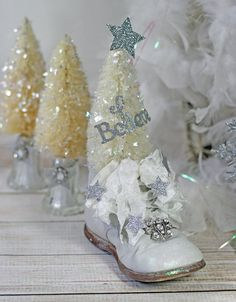 Wonderfully sparkly vintage style bottlebrush tree standing in a vintage baby shoe. Would make a great centerpiece for a Christmas party or even at a baby shower. Hand painted and decorated with handmade details of stars and sparkle and the word Believe. Tree is dusted with vintage style mica glitter. Shoe is weighted for extra stability.  approx 9 tall  **************************************** more bottlebrush trees from CottonridgeEmporium http://etsy.me/n1sAk7  more Christmas items from…