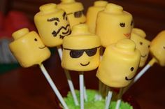 Lego Birthday Party link for lego head pops - use a regular marshmallow with 1/2 a small marshmallow on top dipped in yellow candy melts. use edible pens for features.