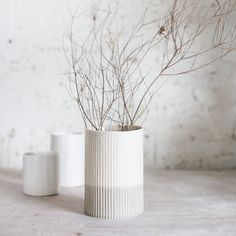 A ceramic vase with a wonderful design of bamboo pattern, providing it a modern and natural look. It is a beautiful addition to your house and