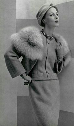 1957 Christian Dior - mock pockets at jacket's waist with button near hem draw attention to the wiast